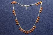 Gemstone necklace with faceted carnelian drop