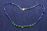 Gemstone necklace with faceted rock crystal ball and malachite and lapis lazuli beads