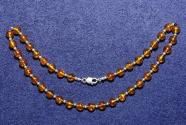 Gemstone necklace with amber beads