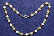 Gemstone necklace with Hawk Eye, aragonite, Unakite, magnesit