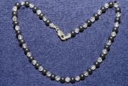 Faceted gemstone necklace with hematite beads and rhinestone