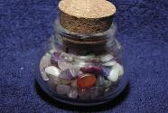 100 g small tumbled stones in glass